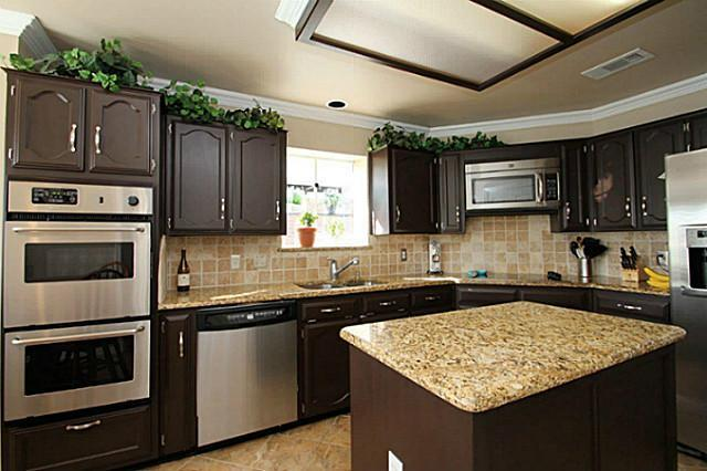 The pueblo sw 7711 walls of this kitchen dining area for Kitchens now