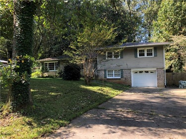 SFR located at 5613 Woodland Drive